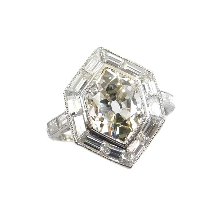 Single stone hexagonal diamond and baguette diamond cluster ring